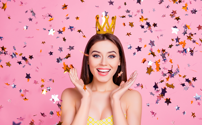 woman wearing a crown on her head smiling