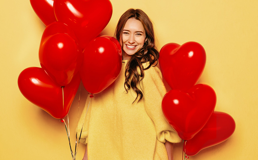 woman with heart-shaped baloons