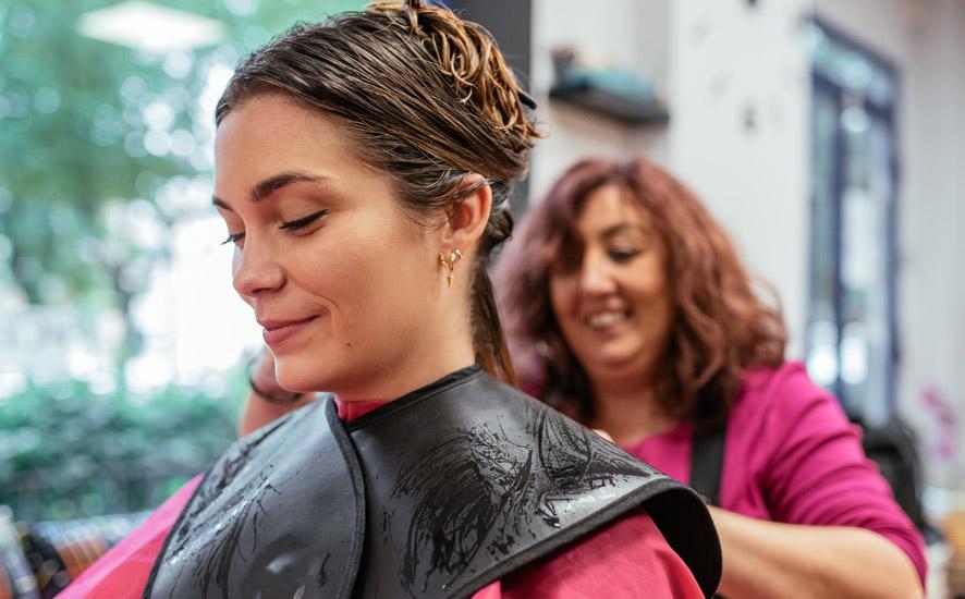 A woman getting hair done